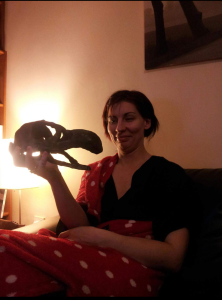A ohoto or caroline holding up a model of a dodo skull