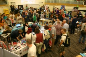 A photo of the Discovery room at Central Library packed with people perusing the stalls
