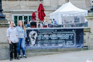 Mark and Jen stood in front of a MakeFest 2017 banner outside the event